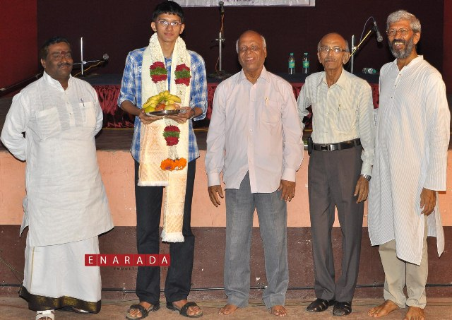 Felicitation to master gagan acharya for securing 1st rank in district (CBSE) 2nd puc