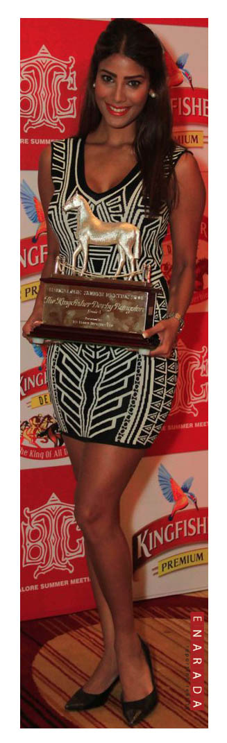 Bollywood actress and Kingfisher Calendar Girl Nicole Faria with the Kingfisher Derby trophy