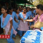 KISS founder Dr Achyuta Samanta gifting pens to tribal students writing Odisha board's tenth standard exams.
